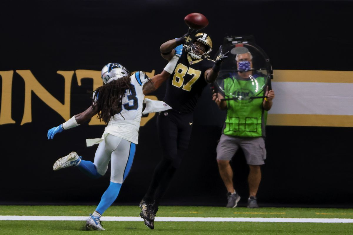 New Orleans Saints tight end Jared Cook (87) catches a touchdown over Carolina Panthers free safety Tre Boston (33) during the first quarter at the Mercedes-Benz Superdome.