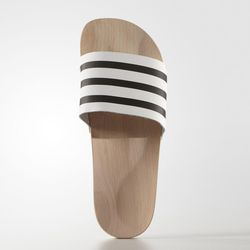 Adidas's new adilette wood slides still have the banded upper with the three stripe design.