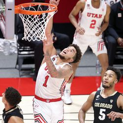 Utah Utes forward Timmy Allen (1) shoots as Colorado Buffaloes guard D'Shawn Schwartz (5) watches during a men's basketball game at the Huntsman Center in Salt Lake City on Monday, Jan. 11, 2021. Utah lost 58-65.