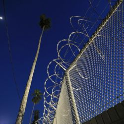 A view of fencing around the U.S. Customs and Border Station at the Brownsville Gateway Port of Entry in Brownsville, Texas, on Monday, Feb. 22, 2021.