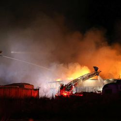 Firefighters battle a two-alarm blaze at a warehouse at 5372 W Colter Dr. on Tuesday, Dec. 30, 2014, in Kearns.