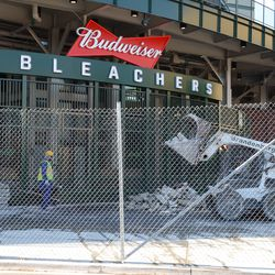 11:24 a.m. Debris being brought out, at the bleacher gate -