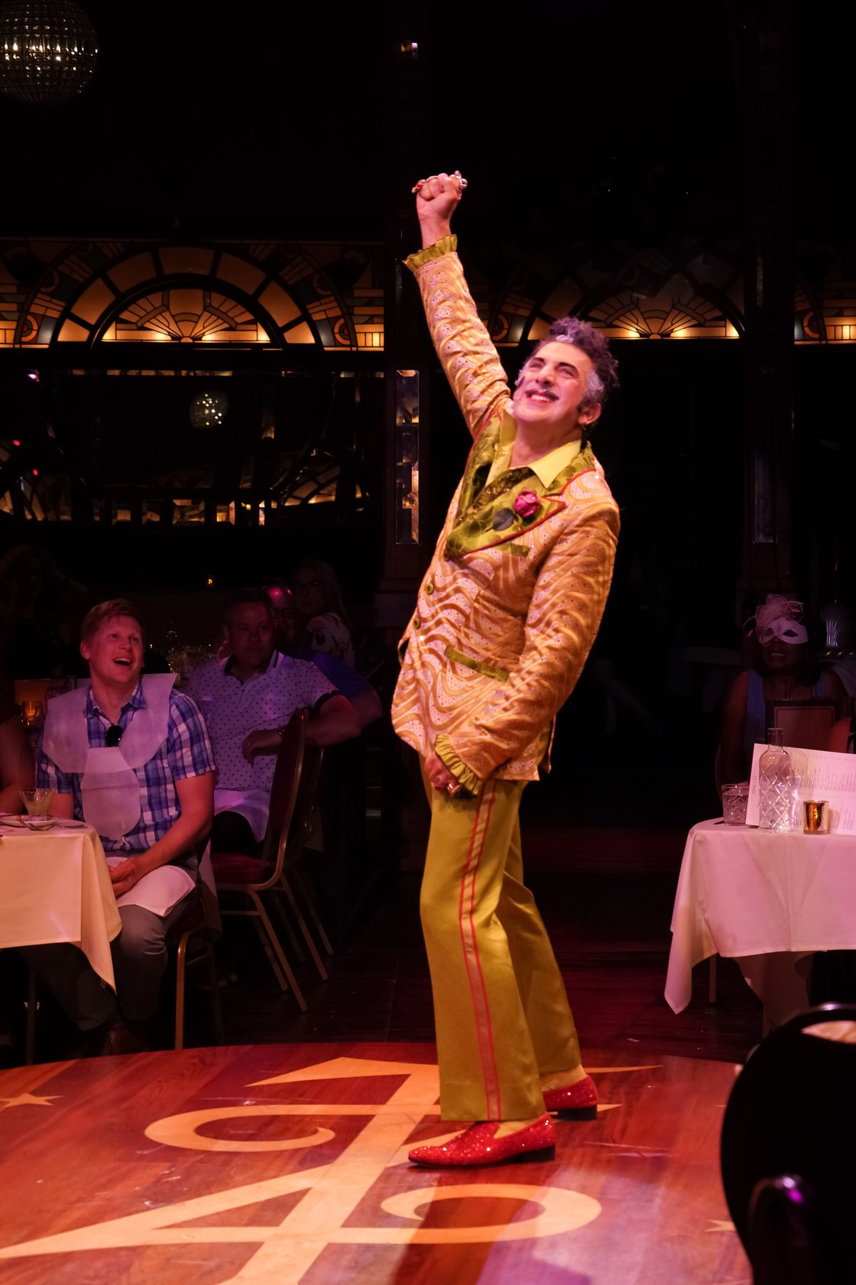 """Frank Ferrante as """"Chef"""" Caeser"""" holds court as the emcee in Teatro ZinZanni's production of """"Love, Chaos & Dinner"""" in Chicago."""