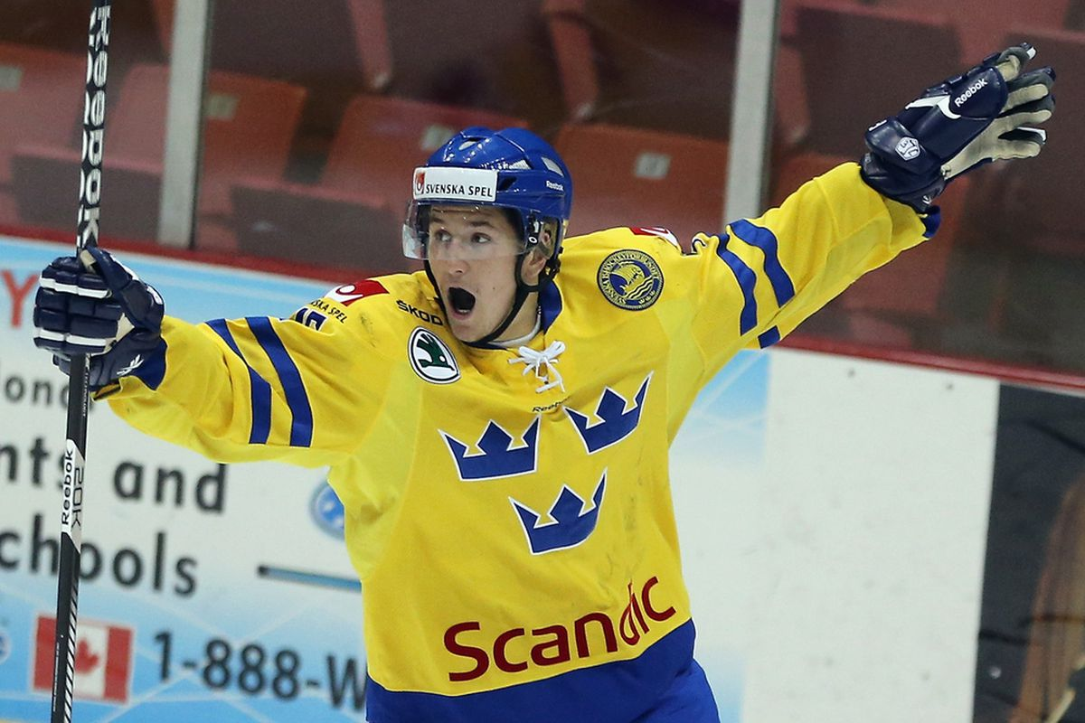 LAKE PLACID, NY - AUGUST 07: Filip Forsberg #16 of Team Sweden skates against Team Finland at the USA hockey junior evaluation camp at the Lake Placid Olympic Center on August 7, 2012 in Lake Placid, New York. Team Sweden defeated Finland 8-2.