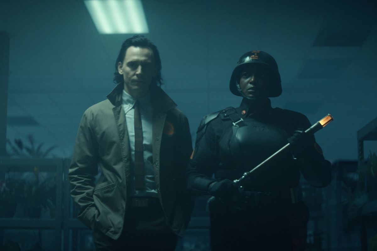 "Loki (Tom Hiddleston) and Hunter B-15 (Wunmi Mosaku) in ""Loki."""