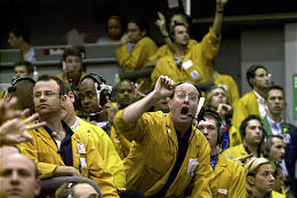 """There's yellow-jacket fever in the Euro Dollar Futures pit at the Chicago Mercantile Exchange as clerks trade after the news that interest rates will remain the same. The Fed said that the rates """"can be maintained for a considerable period."""""""
