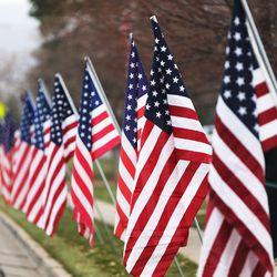 Flags line the street for the funeral of former Utah Gov. Olene Walker in Salt Lake City on Friday, Dec. 4, 2015. Walker died of natural causes at age 85.
