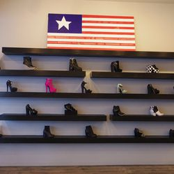 The united wall of shoes, featuring Kelsi Dagger, YRU, Yes, Johnston & Murphy and others.