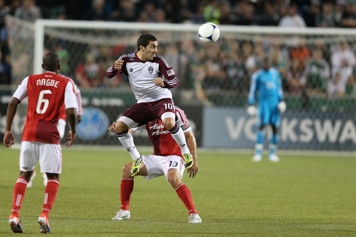 PORTLAND, OR - AUGUST 31: Martin Rivero #10 of Colorado Rapids heads the ball against the Portland Timbers on August 31, 2012 at Jeld-Wen Field in Portland, Oregon. (Photo by Tom Hauck/Getty Images)