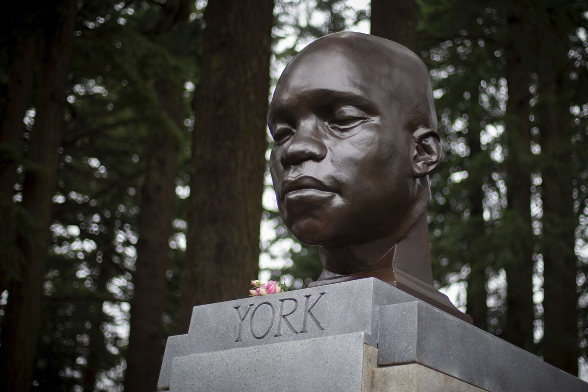 A bust of York, a member of the Lewis and Clark expedition, is seen on Mount Tabor in southeast Portland, Ore., on Sunday Feb. 21, 2021. The statue appeared the day before.