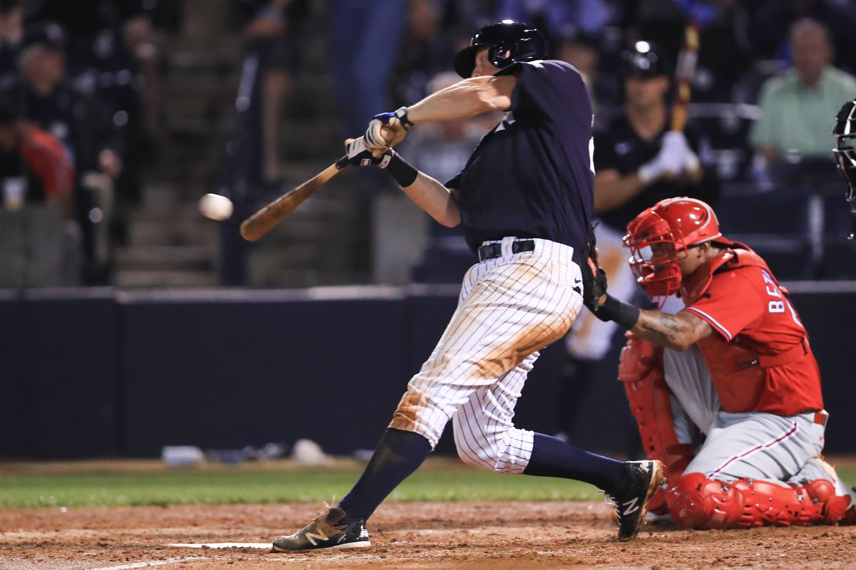 DJ LeMahieu of the New York Yankees singles during the fifth inning of a spring training game against the Philadelphia Phillies at Steinbrenner Field on March 4, 2020 in Tampa, Florida.