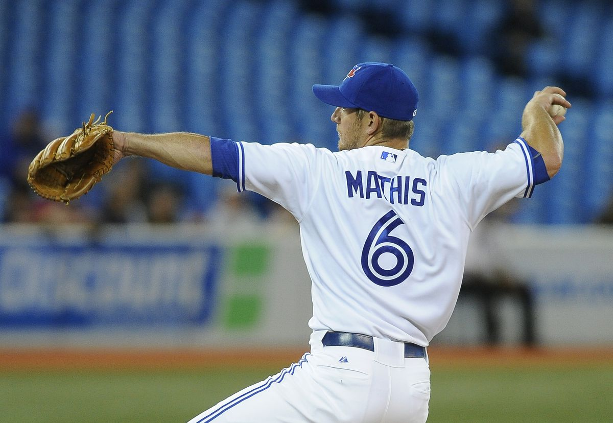 Jeff Mathis #6 of the Toronto Blue Jays delivers a pitch