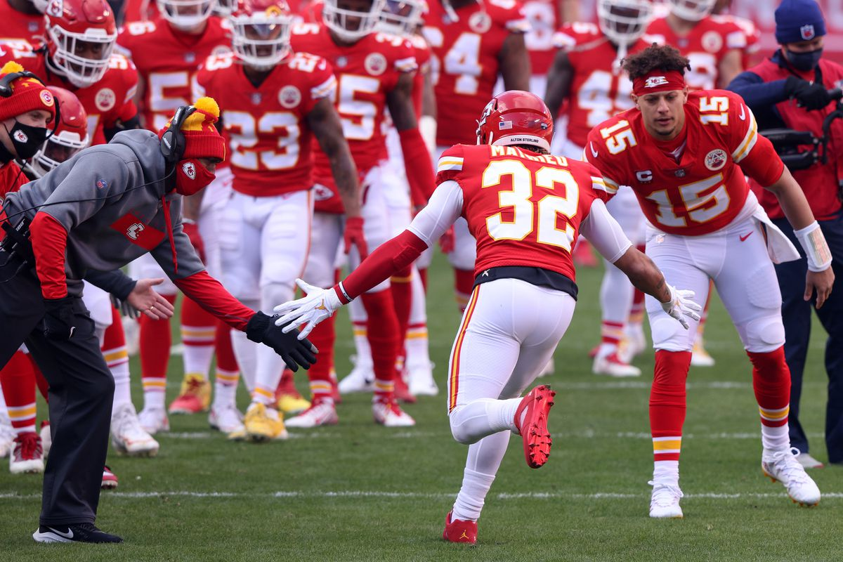 Quarterback Patrick Mahomes #15 of the Kansas City Chiefs welcomes strong safety Tyrann Mathieu #32 onto the field to start the AFC Divisional Playoff game against the Cleveland Browns at Arrowhead Stadium on January 17, 2021 in Kansas City, Missouri.