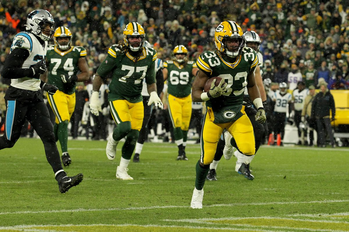Aaron Jones of the Green Bay Packers scores a touchdown against the Carolina Panthers in the game at Lambeau Field on November 10, 2019 in Green Bay, Wisconsin.