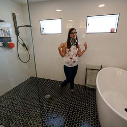 Brooke Andersen shows the shower area and tub that gives her the support she needs in her Provo home on Wednesday, July 7, 2021. Andersen's spinal fusion surgery was delayed because of COVID-19 closures, but she finally made it to Spain during its brief opening window to have it. Now she can walk again, but she's still facing a lifetime of deterioration from her condition.