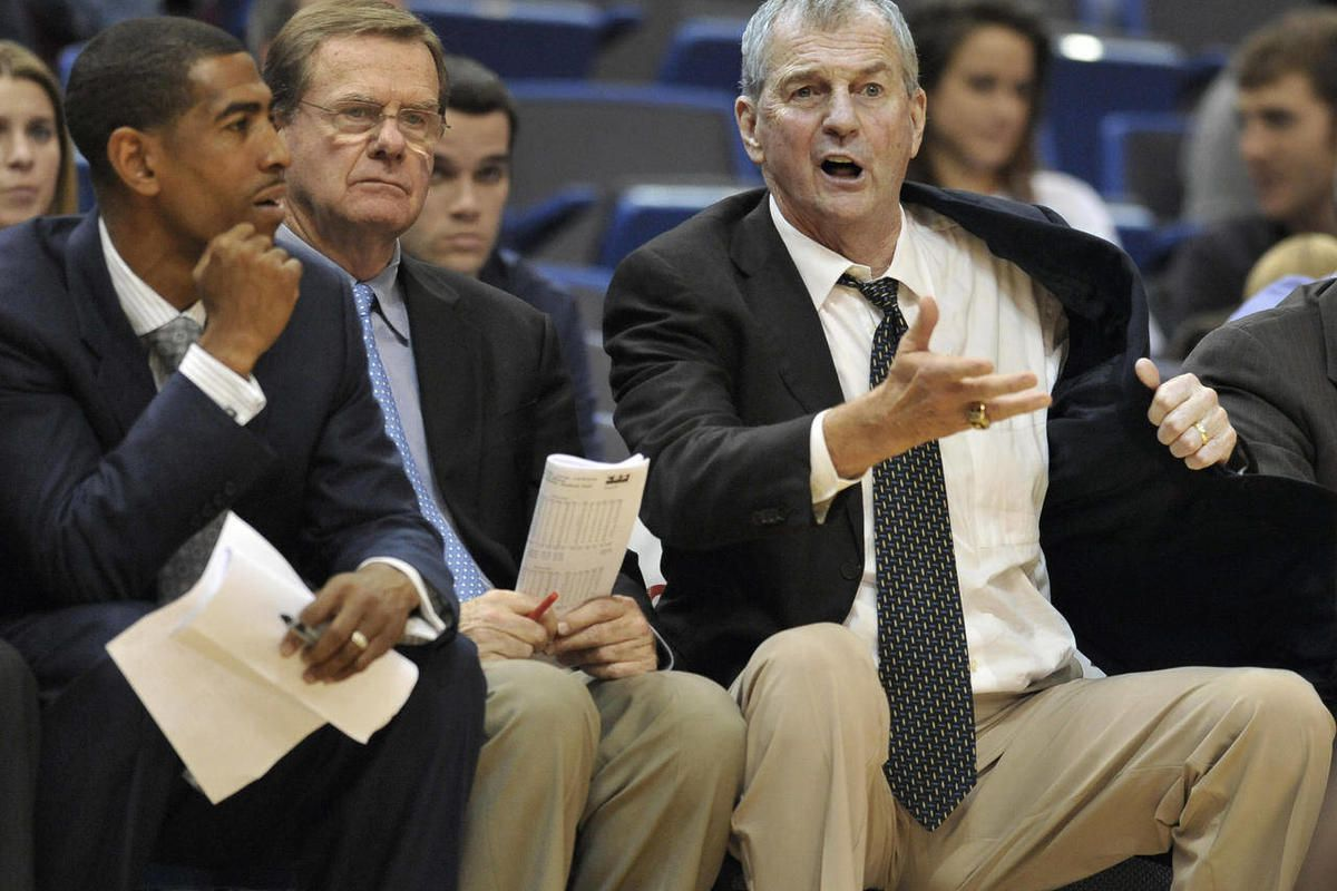 FILE - In this Nov. 20, 2011, file photo, Connecticut head coach Jim Calhoun, right, gestures as assistant coach Kevin Ollie, left, and associate head coach George Blaney, center, look on during the second half of an NCAA college basketball game against C