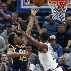 Utah Jazz guard Donovan Mitchell (45) puts the ball behind Cleveland Cavaliers center Tristan Thompson (13) at Vivint Arena in Salt Lake City on Saturday, Dec. 30, 2017.