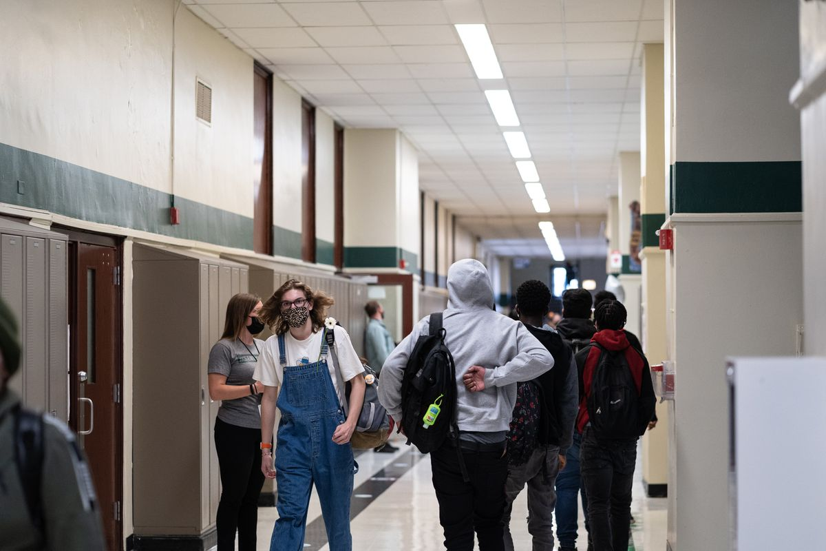 Students walk the halls of Senn High School on the first week back to classrooms on April 23, 2021.