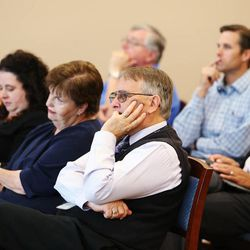 Attendees listens during the Davis County Commission meeting in Farmington, Tuesday, June 30, 2015. Eighty Utah cities and towns passed or considered resolutions this month to support increased transportation funding to meet critical community needs. The funding option was made possible by HB 362.