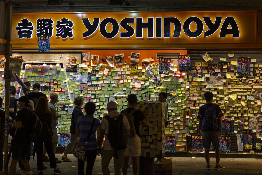 Demonstrators put stickers on a Yoshinoya restaurant.