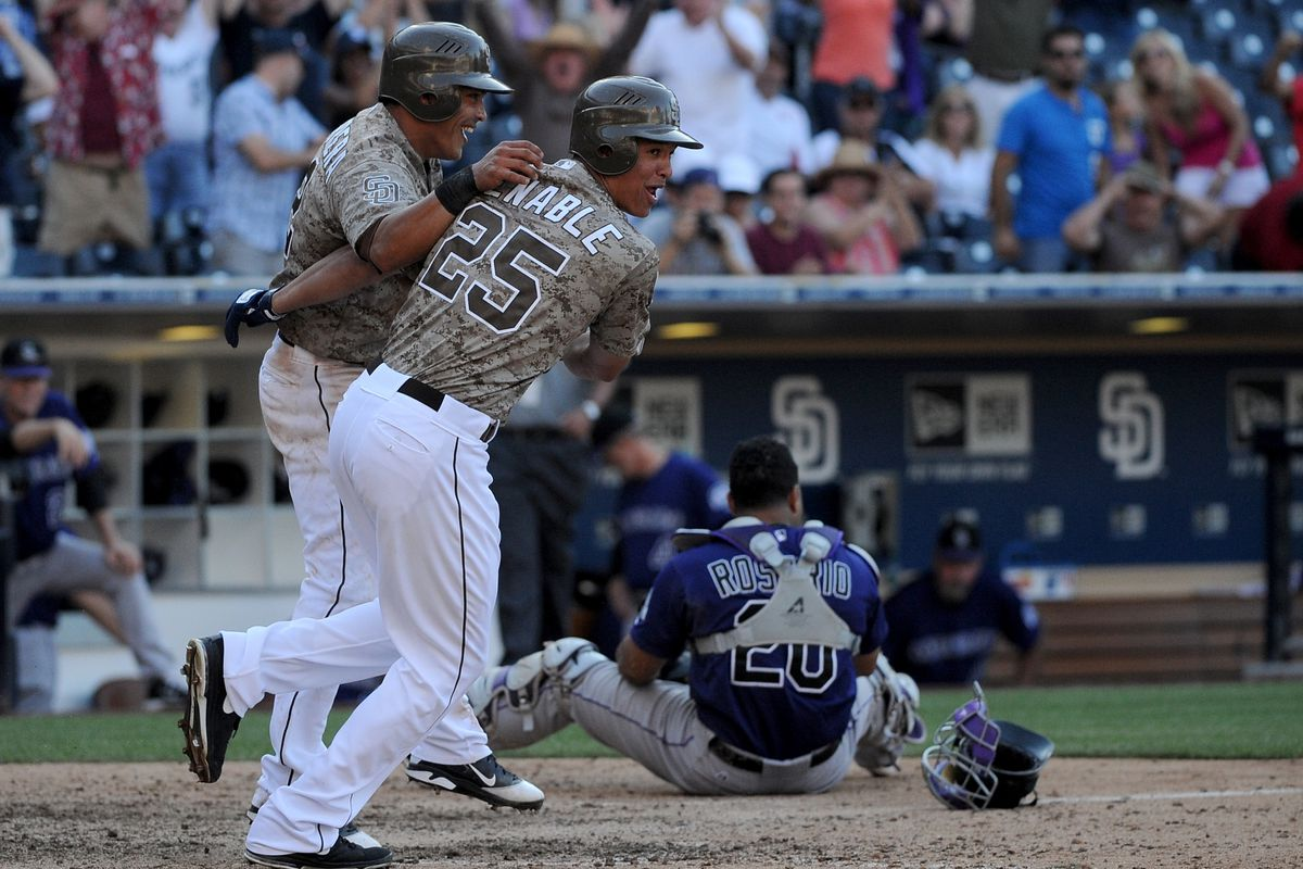 SAN DIEGO, CA - SEPTEMBER 16:  (L-R) Everth Cabrera #2 and Will Venable #25 of the San Diego Padres celebrate defeating the Colorado Rockies 12-11 at Petco Park on September 16, 2012 in San Diego, California.  (Photo by Lisa Blumenfeld/Getty Images)