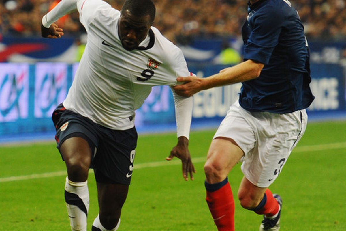 Good example of how France stopped Jozy on Friday. (Photo by Mike Hewitt/Getty Images)