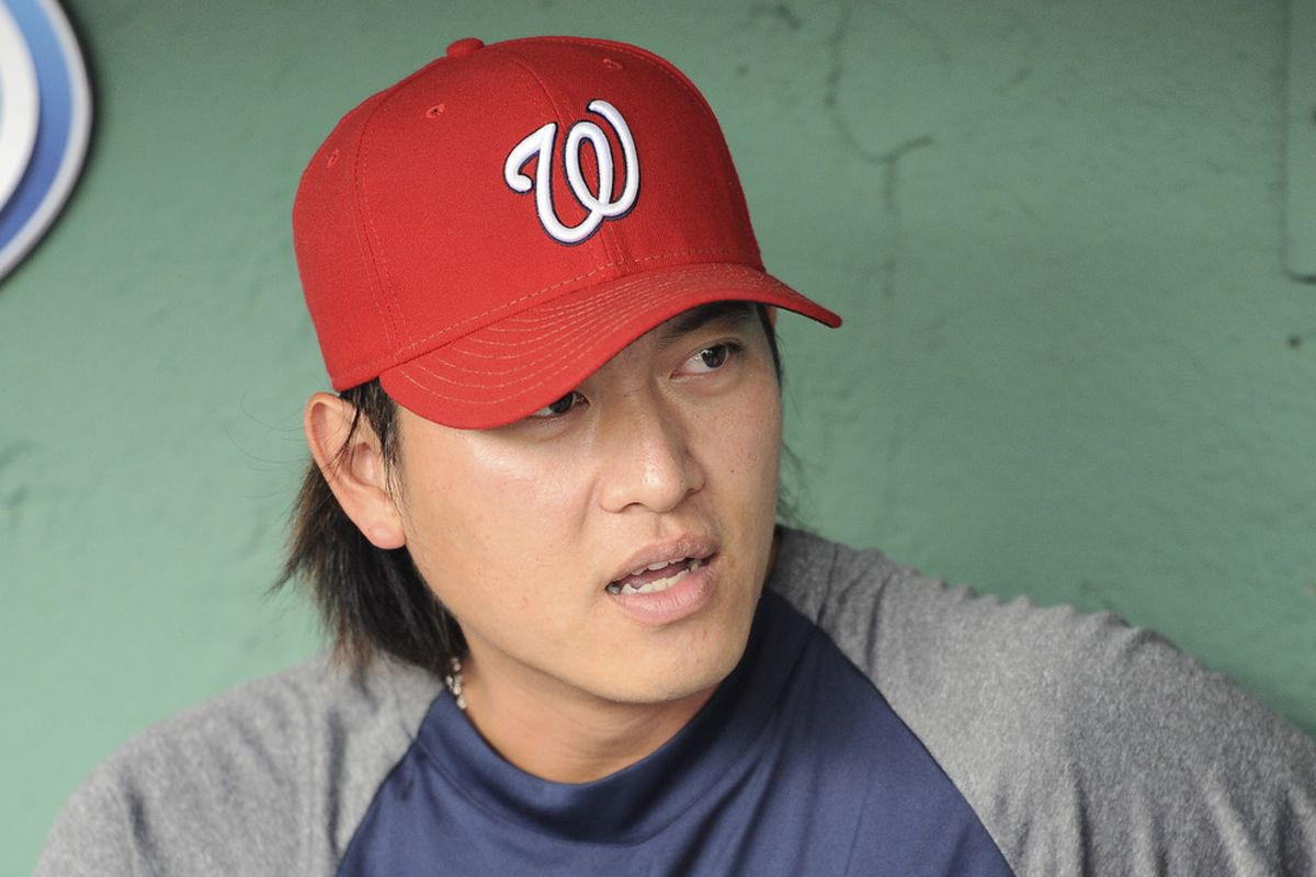 June 8, 2012; Boston, MA, USA; Washington Nationals starting pitcher Chien-Ming Wang (40) talks to a reporter prior to a game against the Boston Red Sox at Fenway Park. Mandatory Credit: Bob DeChiara-US PRESSWIRE