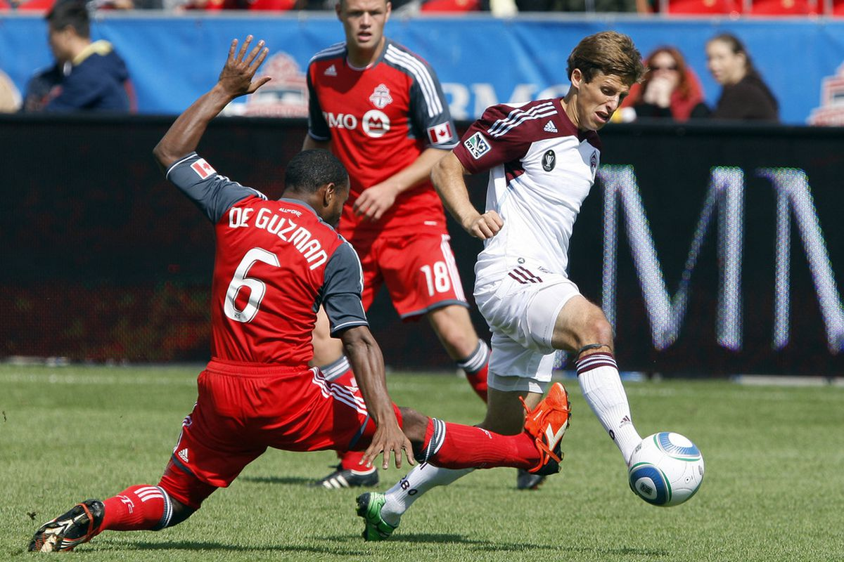 TORONTO, CANADA - SEPTEMBER 17: Julian de Guzman #6 of Toronto FC stops Wells Thompson #15 of Colorado Rapids during MLS action at the BMO Field September 17, 2011 in Toronto, Ontario, Canada. (Photo by Abelimages/Getty Images)