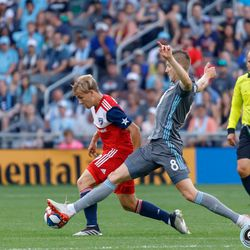 July 13, 2019 - Saint Paul, Minnesota, United States - Minnesota United midfielder Ján Greguš (8) stretches out to knock the ball out from FC Dallas midfielder Paxton Pomykal (19) during the match at Allianz Field.