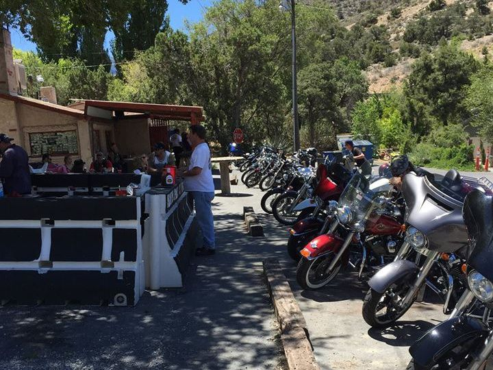 A patio with a lot of motorcycles in front of it