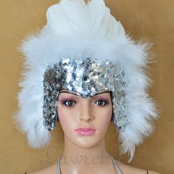 """<b>7. White Feather Sequins Headdress, <a href=""""https://www.etsy.com/listing/97735312/white-feather-sequins-las-vegas-dancer?ref=shop_home_active_12"""">$21</a></b> at Etsy. For the confident bachelorette who basks in attention, this feather headdress will e"""