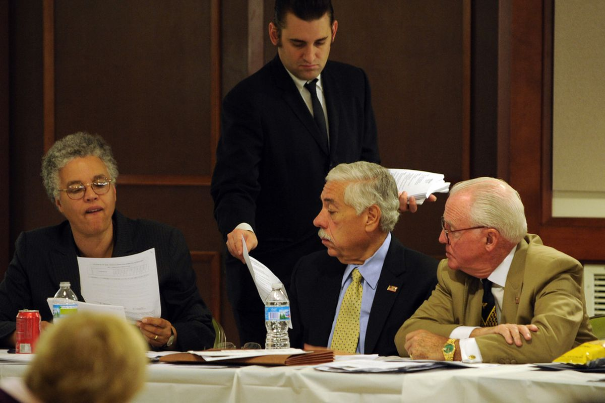 cott Cisek, executive director of the Cook County Democratic Party, passes out resumes of judicial candidates to Cook County Board President Toni Preckwinkle; then Party Chairman Joe Berrios and Ald. Edward M. Burke (14th) at Plumbers Union Hall in 2011.