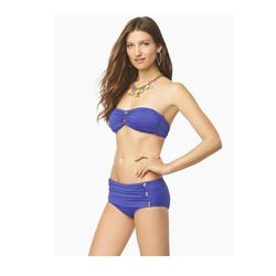 """<a href=""""http://www.juicycouture.com/Miss-Divine-Skirted-Bottom/Y29851,default,pd.html?dwvar_Y29851_color=824&start=8&cgid=swim-bottoms""""> Juicy Couture Miss Divine cinched bandeau bikini top</a>, $49 and skirted bottom, $49 juicycouture.com"""