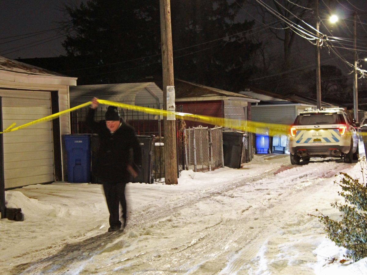 Chicago police investigate the scene where a woman was shot and killed Friday morning in an alley in the 10700 block of South Eberhart Avenue in the Roseland neighborhood. | Justin Jackson/Sun-Times