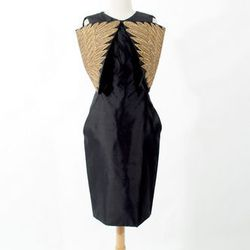 """Alexander McQueen Dress, <a href=""""http://www.shopdecadesinc.com/shop/viewproduct/7641"""" target=""""_blank"""">$3,000</a>. """"This is a breathtaking collectible."""""""