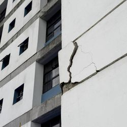 A wall at the University of Costa Rica's school of electrical engineering is damaged after an earthquake in San Jose, Costa Rica, Wednesday, Sept. 5, 2012. A powerful, magnitude-7.6 earthquake shook Costa Rica and a wide swath of Central America on Wednesday.