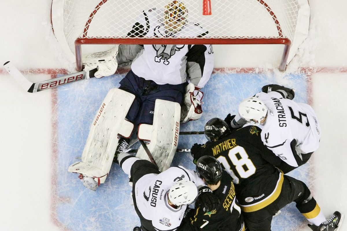 Francis Wathier and Colton Sceviour crash the net in Sunday's game at San Antonio (Credit: Darren Abate)