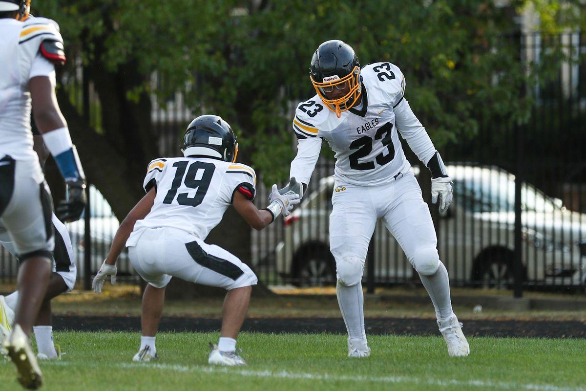 Dyett's Joshua Seay-Chancellor (23) celebrates his touchdown against Chicago Richards.