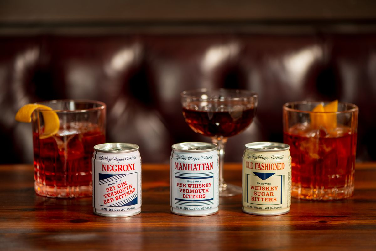 Three canned cocktails in front of three drinks: Negroni, Manhattan, and Old Fashioned