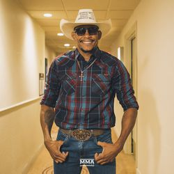 Cowboy Oliveira poses at UFC 231 media day.