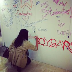 Guests leaving their mark on the event's dedicated tagging wall.