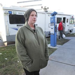 Defendant Ashley Miller talks about her experience with Salt Lake City Justice Courts outside of a borrowed Salt Lake police mobile command center being used as a courtroom in Salt Lake City on Friday, March 27, 2020. Utah's criminal justice system is trying several new things in order to keep the courts running amid the new coronavirus outbreak.