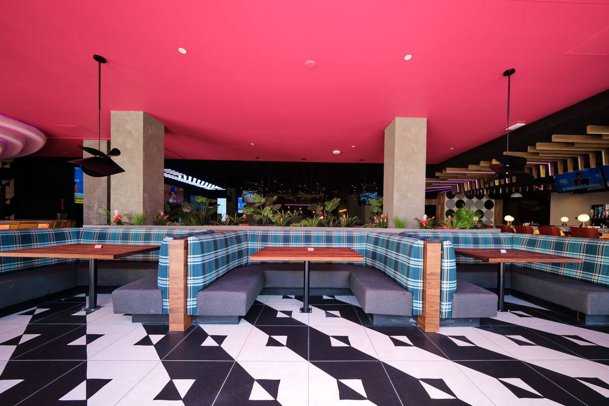 Plaid booths and a pink ceiling