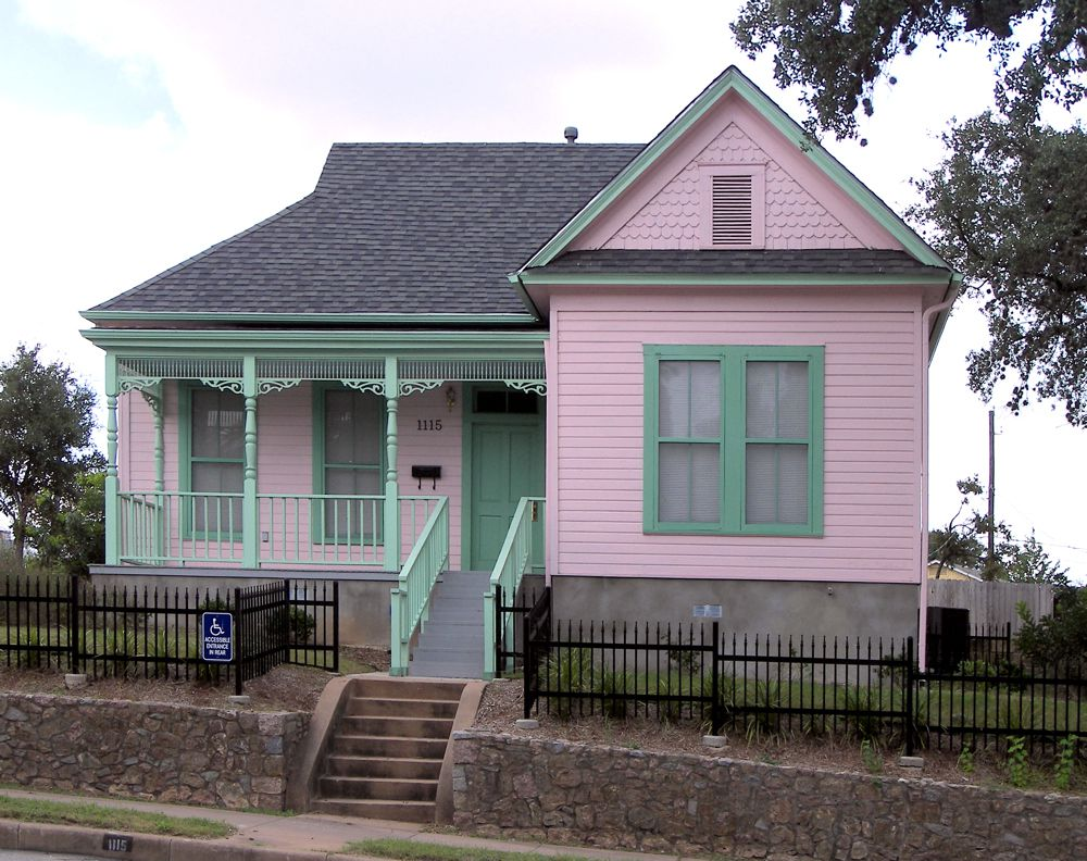Small pink Victorian-era house