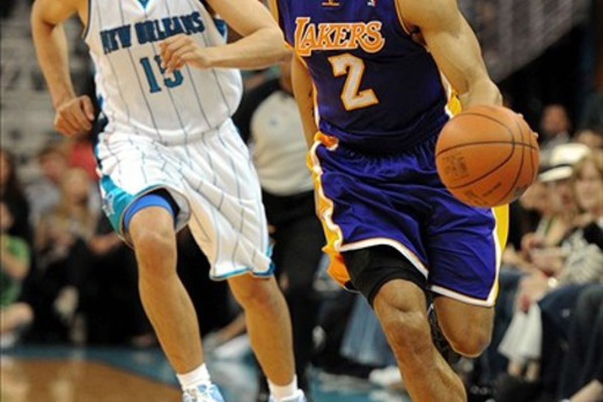 Mar 14, 2012; New Orleans, LA, USA; Los Angeles Lakers point guard Derek Fisher (2) dribbles upcourt against the New Orleans Hornets in the second half of their game at the New Orleans Arena. Mandatory Credit: Chuck Cook-US PRESSWIRE