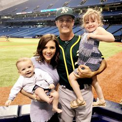 Oakland A's centerfielder Jaycob Brugman with his wife Ali, daughter Millie and son Beck.