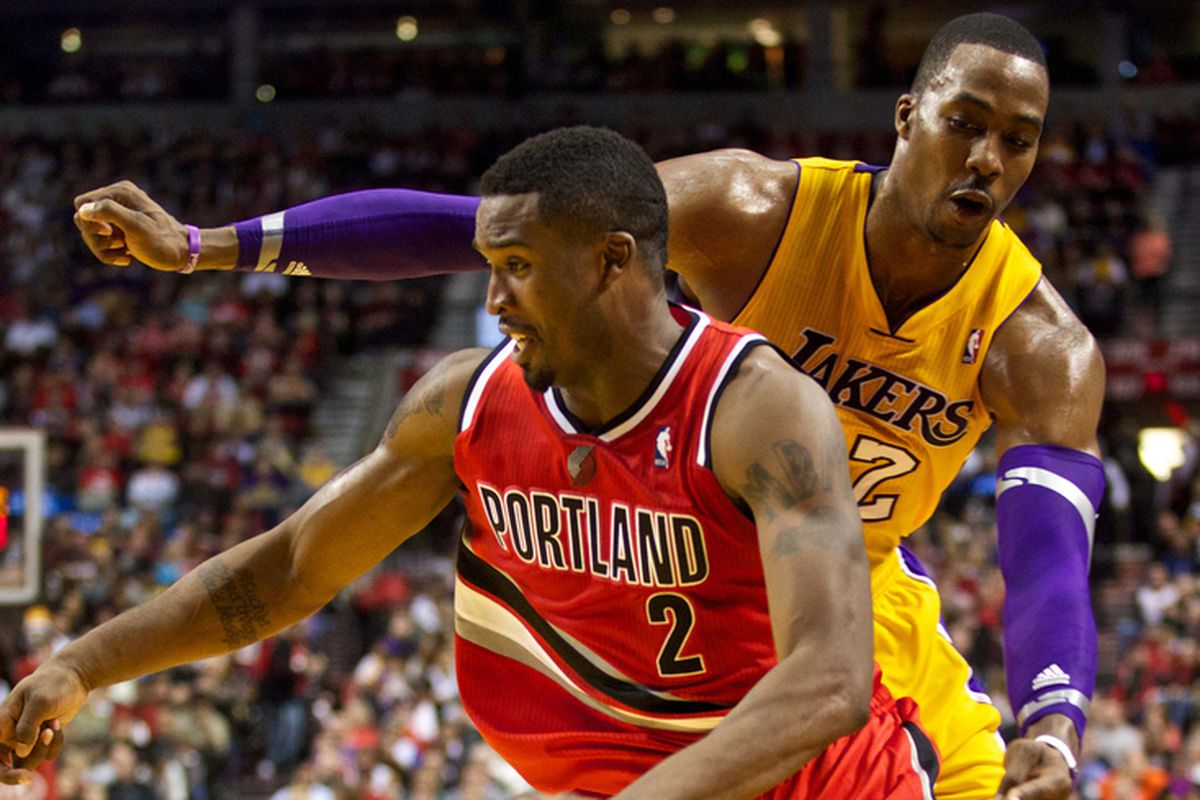 Oct. 31, 2012; Portland, OR, USA; Portland Trail Blazers guard Wesley Matthews (2) drives against Los Angeles Lakers center Dwight Howard (12) during the first half at the Rose Garden.