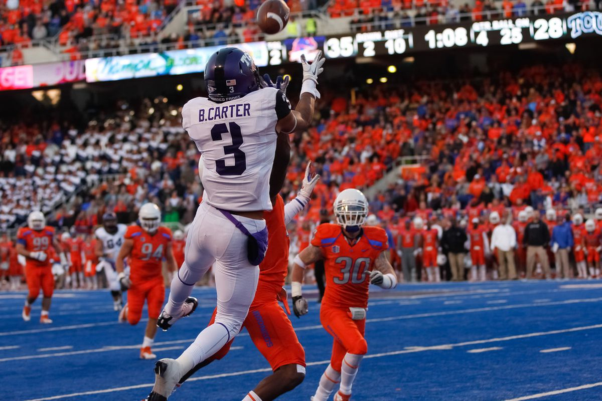 BOISE, ID - NOVEMBER 12:  Brandon Carter #3 of the TCU Horned Frogs makes a catch for a touchdown against the Boise State Broncos at Bronco Stadium on November 12, 2011 in Boise, Idaho.  (Photo by Otto Kitsinger III/Getty Images)