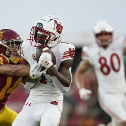 Utah wide receiver Theo Howard (1) makes a catch next to Southern California cornerback Jayden Williams (14) during the first half of an NCAA college football game Saturday, Oct. 9, 2021, in Los Angeles.