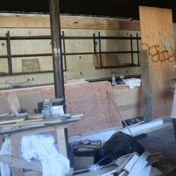 Churchill's future bar will have steel shelving behind it. No more stripper poles.